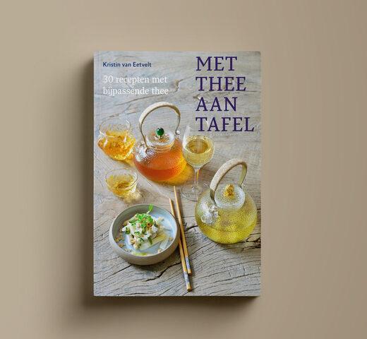 Paperback-cover-Mockup-Met-thee-aan-tafel